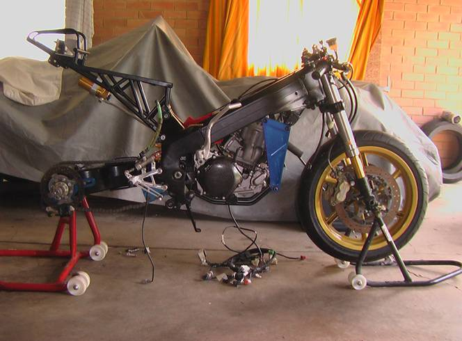 nrs500 stage 2 the bike was striped down and all the parts sent to the powder coater to have matt black applied to them once i had received the parts from the powder